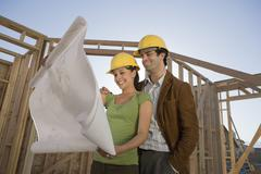 Couple Reviewing Blueprint - stock photo