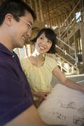 Couple Discussing Architectural Blueprint Stock Photos