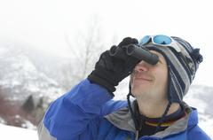 Stock Photo of Man Looking Through Binoculars