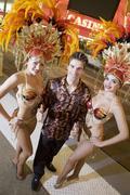 Man Standing With Casino Dancers Stock Photos