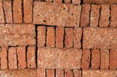 new red brick pile prepare for construction. - stock photo