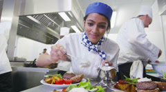 Delicious meal being given the finishing touches by chef in a commercial kitchen Stock Footage