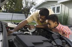 Man Checking The Engine Of Car - stock photo