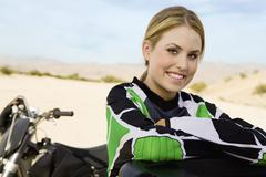 Happy Female Off Road Motor Biker - stock photo