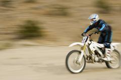 Off Road Biker Riding The Motor Bike Stock Photos