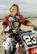 Mother And Son Sitting On Motorbike - stock photo