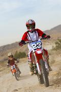 Mother And Son Riding Motorbike - stock photo