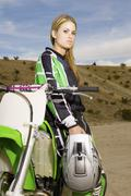 Stock Photo of Female Rider With Helmet At Track