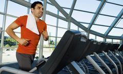 Man Exercising On Treadmill In Gym Stock Photos