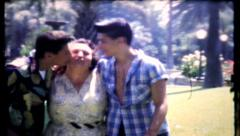 31 - mom & the boys at the park - vintage film home movie Stock Footage