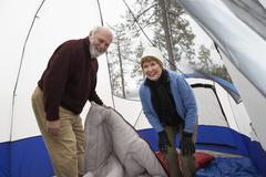 Stock Photo of Senior Couple Camping In Tent