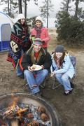 Happy Family At Campfire In Winter - stock photo