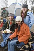 Family Having Food In Front Of Tent Stock Photos