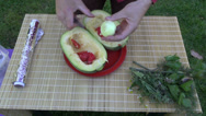 Stock Video Footage of preparing fresh zucchini for cooking in foil