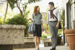 Happy Business People Walking On Sidewalk Stock Photos