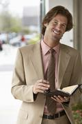 Businessman Holding Organizer Stock Photos