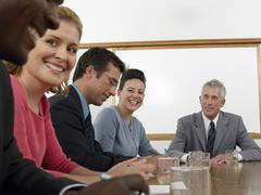 Business People Discussing In Conference Room Stock Photos