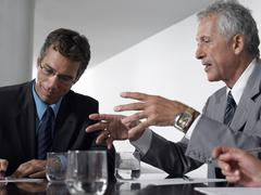 Business Men In Conference Room - stock photo