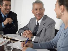 Stock Photo of Business People Discussing At Conference Table