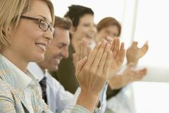 Business People Applauding At Conference Table Stock Photos
