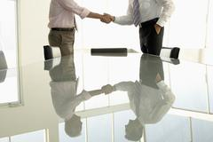 Business People Shaking Hands In Conference Room Stock Photos