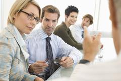 Stock Photo of Business People Discussing In Conference Room