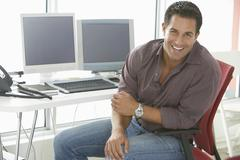 Smiling Businessman Sitting On Office Chair - stock photo