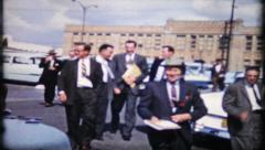 Businessmen return to work after lunch, 565 vintage film home movie Stock Footage