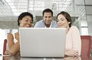 Business People Using Laptop At Conference Table Stock Photos