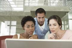 Tensed Business People Using Laptop - stock photo