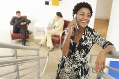 Young Businesswoman Using Mobile Phone On Stairway Stock Photos