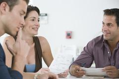 Business People Reviewing Documents In Meeting - stock photo