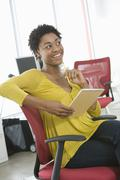 Businesswoman With Notepad And Pencil Sitting On Chair Stock Photos