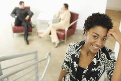 Young Businesswoman Standing On Stairway - stock photo