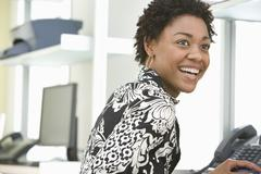Stock Photo of Businesswoman Working At Office Desk