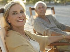 Senior Couple Relaxing On Tropical Beach - stock photo