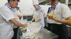 Chefs in restaurant or bakery kitchen preparing dough for bread or pastry Stock Footage