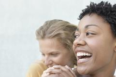 Stock Photo of Young Woman With Female Friend Having Fun Together