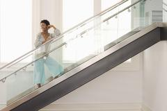 Stock Photo of Woman Standing On Modern Glass Stairs