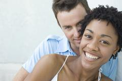 Stock Photo of Loving Young Couple Smiling