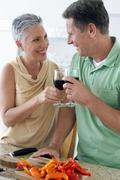 Couple Standing Together With Wine Glass Stock Photos