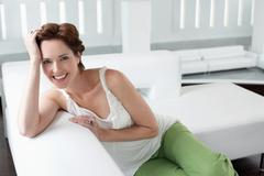Beautiful Young Woman On Sofa In Living Room Stock Photos
