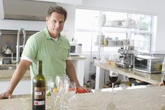 Stock Photo of Senior Man Standing In Kitchen