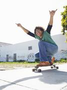 Young Man Holding Skateboard - stock photo