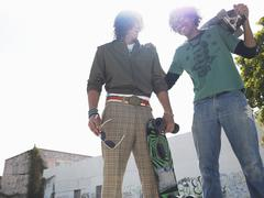 Cheerful Young Men With Skateboarders Stock Photos