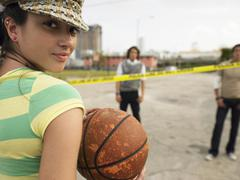Young Female Holding Basketball Stock Photos