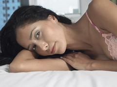 Beautiful Young Woman Lying In Bed - stock photo