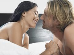 Couple About To Kiss On Bed Stock Photos
