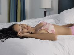 Woman In Lingerie Sleeping On Bed - stock photo