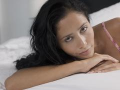 Stock Photo of Young Woman Relaxing In Bed